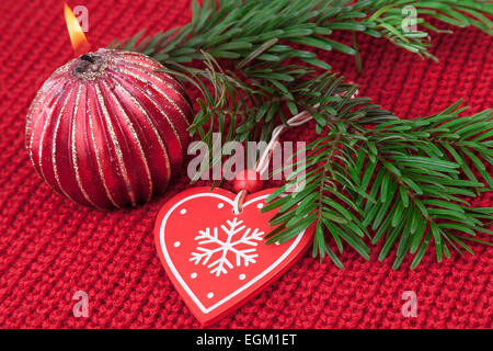Christmas decoration on red wool knitted fabric background - Stock Photo