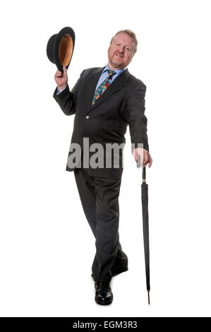 Happy middle aged man in suit holding bowler hat, with umbrella, isolated on white - Stock Photo