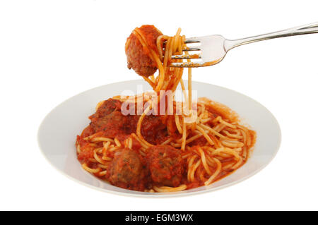 meatballs and spaghetti on a plate with a fork isolated against white - Stock Photo