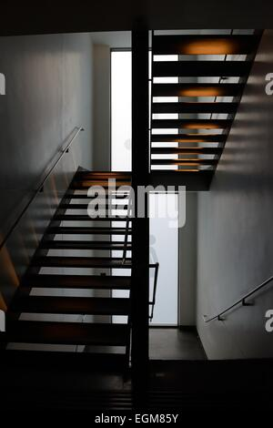 Open tread flight of stairs in the lighthouse building in Glasgow, Scotland - Stock Photo