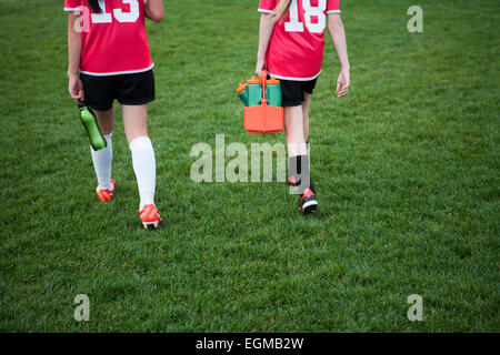 Two Young Female Soccer Players Walking off Field, Rear View - Stock Photo