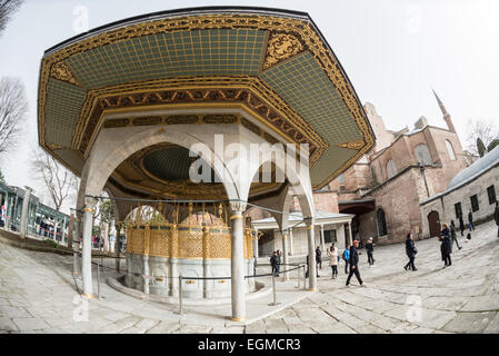The ornately decorated ablutions fountain in the courtyard of Hagia Sophia. Originally built in 537, it has served - Stock Photo