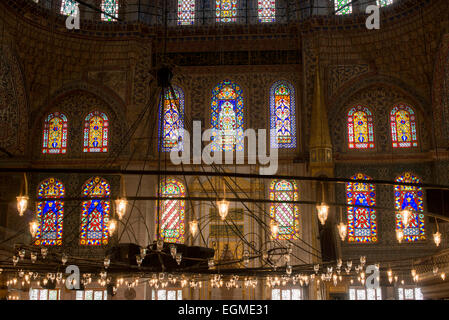 The ornate decorations inside the prayer hall of Istanbul's Blue Mosque. While it is widely known as the Blue Mosque - Stock Photo