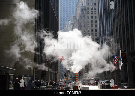 Steam rises from a vent near Wall Street in the Financial District, Downtown Manhattan,  New York City, USA. 16th - Stock Photo