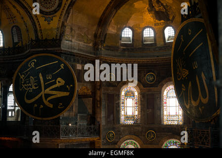 Large circular medialions hanging Hagia Sophia. They inscribed in Arabic with the names of Allah, Muhammad, the - Stock Photo
