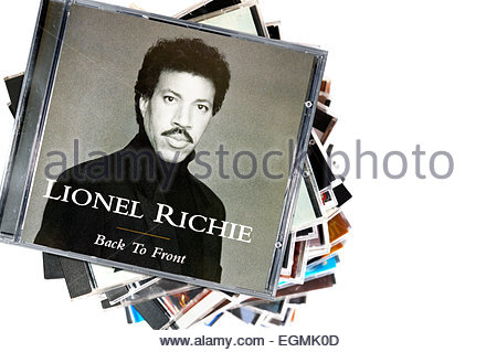 Lionel Richie 1992 album back To Front, piled music CD cases, England - Stock Photo