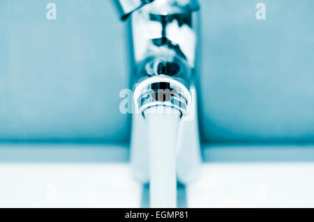closeup of a water running from a faucet - Stock Photo