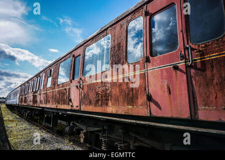 An old railway carriage rusting on a siding in York, England, UK. - Stock Photo