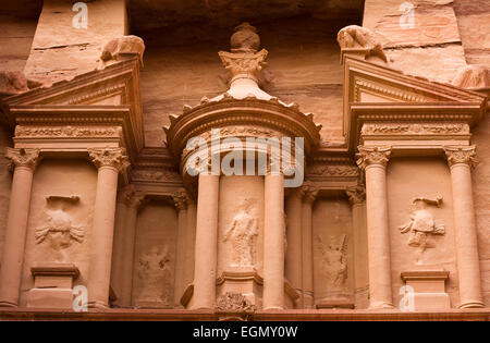 The upper part of the Treasury. The treasury is also called Al Khazna, it is the most magnificant and famous facade - Stock Photo