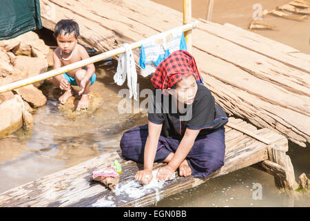 Local woman washing clothes on the banks of the Bani river ...