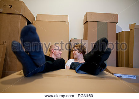 Young couple taking a rest while moving in new home, Berlin, Germany - Stock Photo