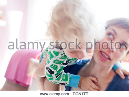 Boy raging on her mother, Sankt Augustin, Germany - Stock Photo