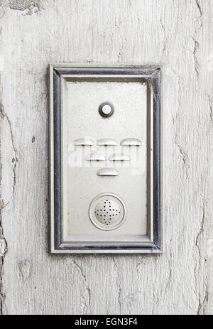 Old intercom in a house, detail of a electric apparatus in the facade of a building - Stock Photo