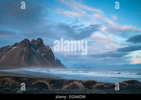 Dramatic scenery with black sand dunes, beach and mountains at Vestrahorn mountains, Hofn, Stokksnes, South Iceland - Stock Photo