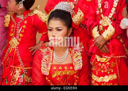 Beautiful young burmese woman dressed in ceremonial dress, Mahamuni Buddha temple, Mandalay, Myanmar ( burma ), - Stock Photo