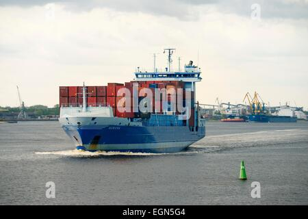 Riga Latvia. Merchant cargo shipping on the Daugava River in the Freeport of Riga. Container vessel ship Aurora - Stock Photo