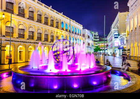 People enjoy Senado Square in Macau, China. - Stock Photo