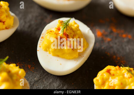 Homemade Spicy Deviled Eggs with Paprika and Dill - Stock Photo