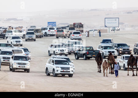 Emirati people in their cars at Al Dhafra Camel Festival in Al Gharbia. Madinat Zayed, Emirate of Abu Dhabi - Stock Photo