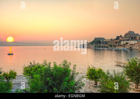 Sunrise at the sailing club in old fortress of Corfu, Greece - Stock Photo