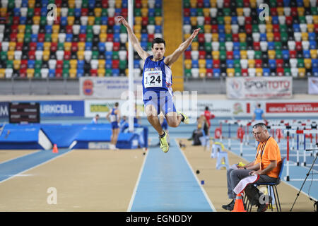ISTANBUL, TURKEY - FEBRUARY 21, 2015: Armenian athlete Artak Hambardzumyan long jump during Balkan Athletics Indoor - Stock Photo