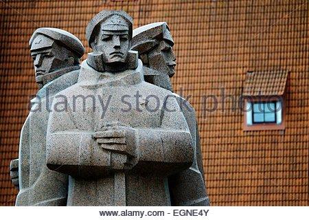 Riga Latvia. Soviet era Latvian Riflemen Monument outside Occupation Museum commemorates pro Bolshevik anti German - Stock Photo