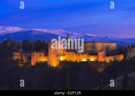 Alhambra, UNESCO World Heritage Site, Sierra Nevada and la Alhambra at Dusk, Granada, Andalusia, Spain - Stock Photo