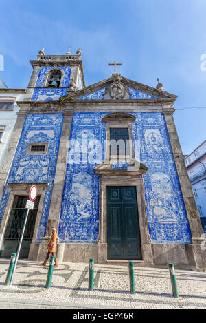 Porto, Portugal. Santa Catarina Chapel, aka Almas Chapel decorated with the typical Portuguese Blue Tiles aka Azulejos. - Stock Photo