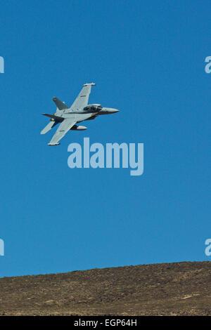 US Navy EA-18G Super Hornet, Growler, Jet Fighter, Maneuvering In The Skies Above The Californian Desert. - Stock Photo