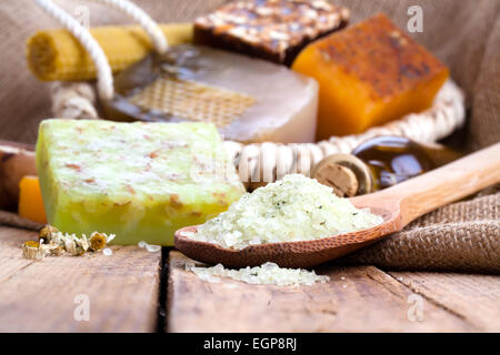 Aromatic spa set with sea salt and soap, on wooden background - Stock Photo
