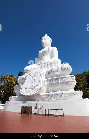 A Big White Buddha Statue at the Temple on the Hill (Wat Phra That Mae Yen) in Pai, Thailand - Stock Photo