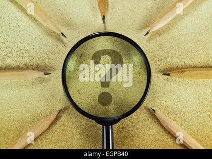 Question mark under magnifying glass on vintage background - Stock Photo