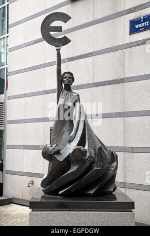 The 'Europe' statue by May Claerhout, holding the symbol of the Euro outside the European Parliament, Brussels. - Stock Photo