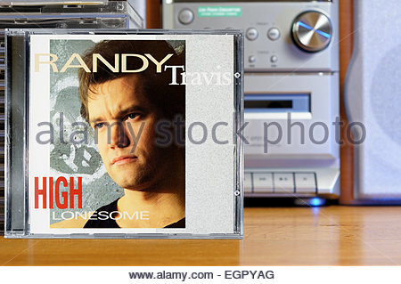 Randy Travis 1991album High Lonesome, piled music CD cases, England - Stock Photo
