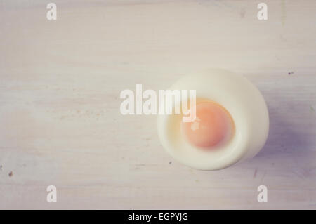 Half boiled egg on the table top view - Stock Photo
