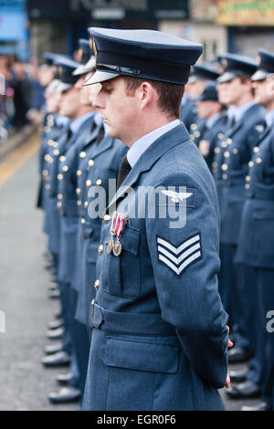 England, Ramsgate. Remembrance Sunday. Line of RAF men standing to attention, seen from side and front - Stock Photo