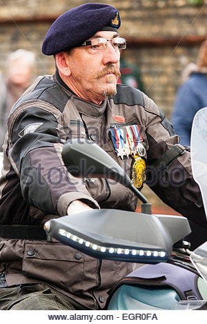 England, Ramsgate. Remembrance Sunday. Parade, old soldier, wearing black beret and medals, sitting on motorbike - Stock Photo