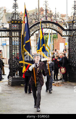 England, Ramsgate. Remembrance Sunday. Parade, standard bearers coming through church gates - Stock Photo