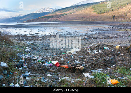 Rubbish on the shore of Lake Long in Scotland - Stock Photo
