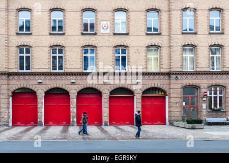 Berlin old fire station (1883) still operational - brick building with red doors in Oderberger strasse, Prenzlauerberg, - Stock Photo