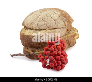 slices of bread and red berries of mountain ash - Stock Photo