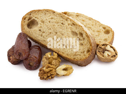 still life sliced ​​bread, dates and nuts on a white background - Stock Photo