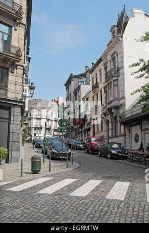 View up Charles Hanssens St, a cobbled street in Brussels, Belgium. - Stock Photo
