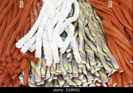 Licorice colors, detail of jellybeans in a medieval market - Stock Photo