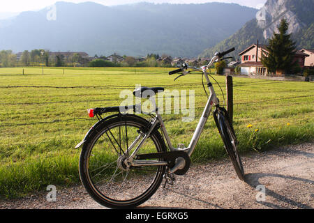 Two wheeler cycle in rural path in Interlaken, Switzerland - Stock Photo
