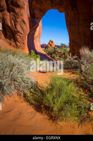 Pinetree Arch in Arches National Park, a US National Park in eastern Utah. - Stock Photo