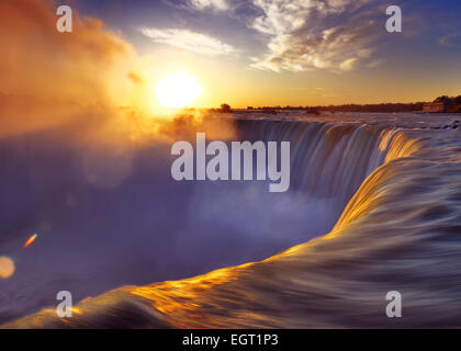Brink of Niagara Falls Canadian Horseshoe beautiful sunrise scenery. Niagara Falls, Ontario, Canada. - Stock Photo