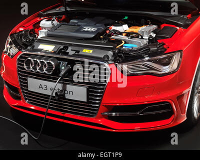 Closeup of Audi A3 e-tron electric car with a power plug being charged - Stock Photo