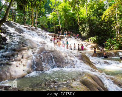 Tourists Bathing And Climbing The Dunn S River Falls Ocho