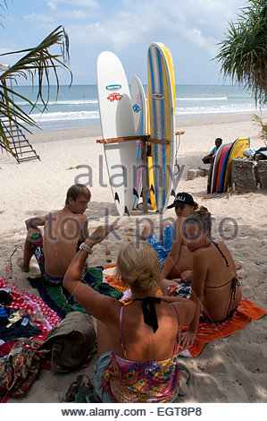 Lessons of surf on the beach of Kuta. Surfing lessons. Bali. Kuta is a coastal town in the south of the island of - Stock Photo